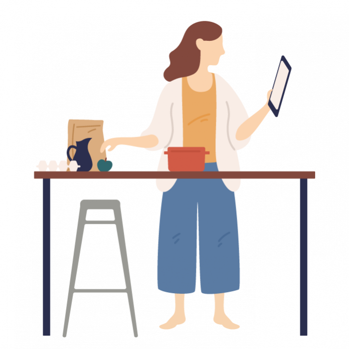 Illustration of a woman stood up at a kitchen table, reading her tablet whilst preparing food